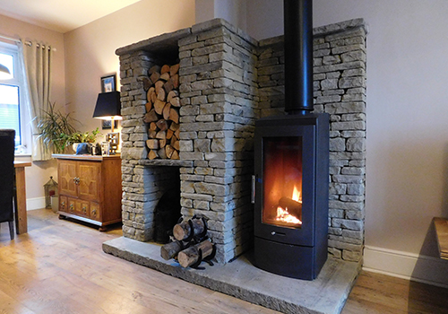 Our dry-stone log store and fire hearth provides an atmospheric feature in this lovely cottage.